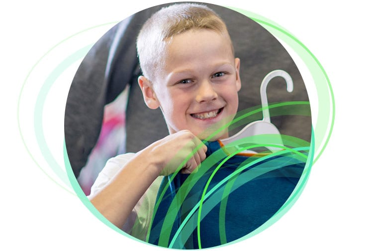 Young boy holding up clothing item for Lowes intranet case study.